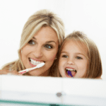 Image of mom and daughter brushing teeth