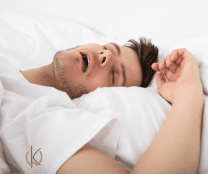 Man sleeping on back with mouth open