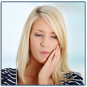 A woman grabbing the side of her mouth in need of an emergency dentist