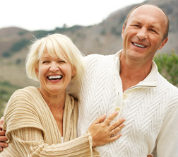 Middle-aged couple outdoors - for information on natural-looking dentures