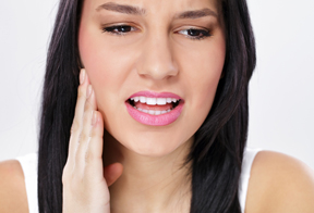 Photo of woman in dental pain - emergency dentist