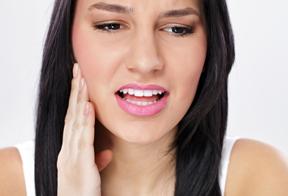 Photo of woman in dental pain - emergency dentist
