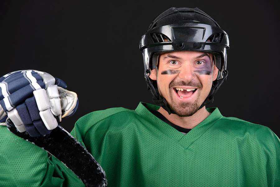 Hockey player with missing tooth wearing his gear